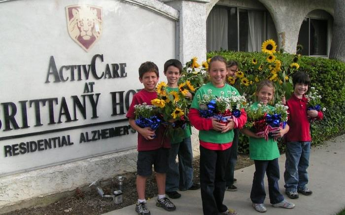 Students deliver flowers grown in our garden to care facility.