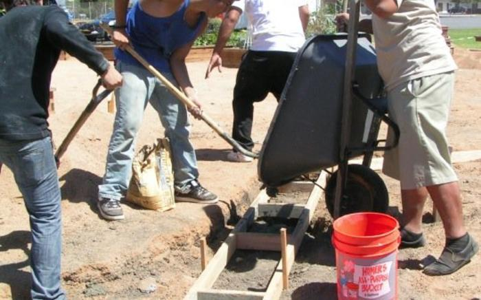 ACE students pour footings